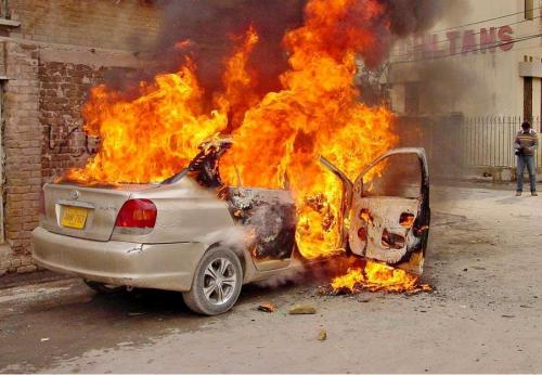 A vehicle burnt by unknown conspirators.