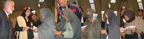 Fed. Minister Farzana Raja distributing check under BISP among Hazara women.