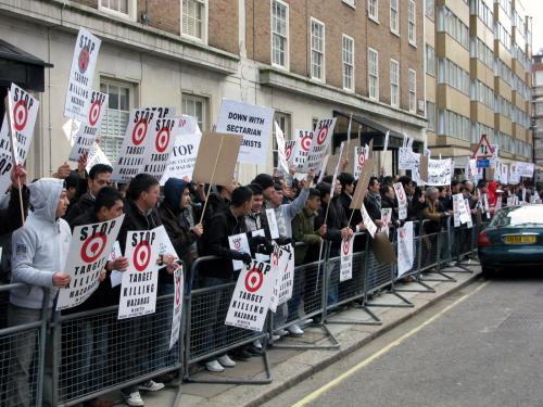 Protesters holding placards in front of Pak Embassy, London.