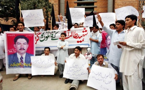 Hazara Qawma Jirga protests against non arrest of Talib Agha's murderers in front of Quetta Press Club on July 24.