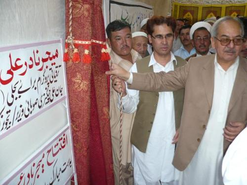 Provincial Minister Jan Ali Changazi and Major (Retired) Nadir inaugurating the electricity project.