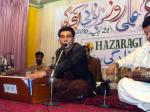 Asad Sarkhosh entertaining the audience with Hazaragi songs.